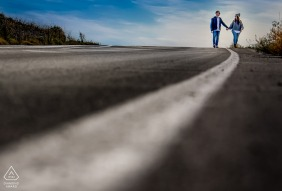Mojacar - Spain couple Strolling down the road next to the painted line during engagement portrait session