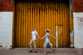 Western Australia Fremantle couple Walking together during engagement portrait session.