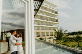 Phu Quoc Island pre-wedding photographer| a kiss in the room with a beautiful view