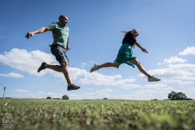 Domalain, France Couple is jumping during pre-wedding portrait session
