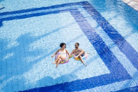Turkey engagement photography at the Mersin Hilton Hotel	- a couple posing in a swimming pool