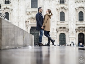 A couple holding hands in Milano, Italy during their prewed engagement portrait shoot
