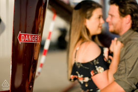 "West Houston Airport | Interesting word play with a helicopter warning ""Danger"" with the couples in the background."