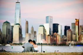 "Liberty State Park engagement portrait | PreWed Photographer: "" 	It was a beautiful sunset with soft pink and blue hue and I asked my couple to just relax on the lawn."""