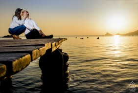 A couple kisses on a dock in Aguilas, Spain during a prewed photoshoot
