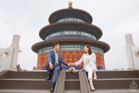 China beijing pre-wedding engagement couple portrait with a round building and steps