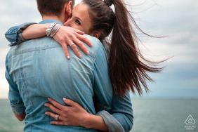 Trieste, Italy engagement portrait session at the sea with love, Wind and hugs