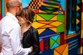 Burano, Venezia, Italy Tenderness engagement couple portrait with colorful artwork