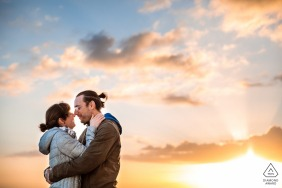 Brighton, UK Sunset love engagement portrait with a bright sky and great clouds