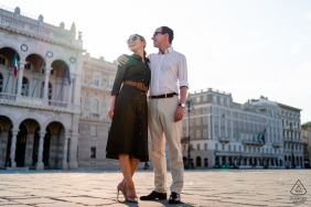 Happy couple in Piazza Unità d'Italia during an engagement shoot in Trieste, Italy