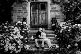 West Chester PA engagement session at a college campus while the couple sits on steps