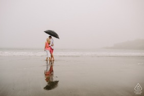 Romance in the Rain during a beach portrait session in York Harbor Beach, York Maine