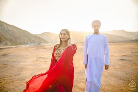 muscat summer love in the desert sun and wind during pre-wedding photoshoot
