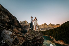 a Couple waiting for the sunrise during their engagement portrait shoot at Moraine Lake, Banff National Park, AB, Canada