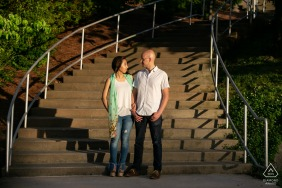 Georgia Tech University Campus Couple posed on steps in the afternoon sunlight