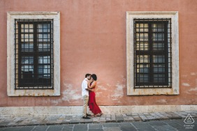 Engagement portrait session in the urban streets of San Quirico d'Orcia, Tuscany