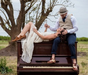 Argentina Engagement portraits sitting on a piano in the fields of Provincia de Buenos Aires