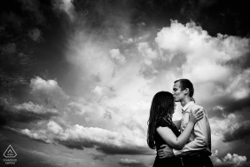 Dramatic cloudy backdrop for an engagement couple portrait in Rosice