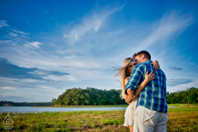 Linhares, Espírito Santo, Brazil engagement portrait of couple near water in a field