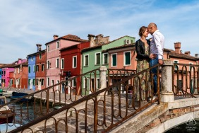 Burano, Venezia, Italy portrait session shoot with a couple sharing Hugs on the bridge