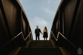 engaged Couple on bridge in Crescent Park during their New Orleans, Louisiana pre-wedding photo session
