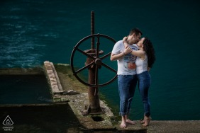 Umbria engagement image of couple at the dock.