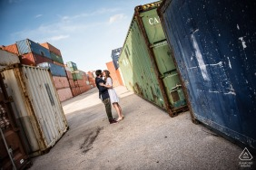 A couple in an industrial harbour during their engagement photoshoot in Le Havre, France