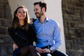 Biarritz, France Lovers smiling and sitting outdoors for their engagement portrait session