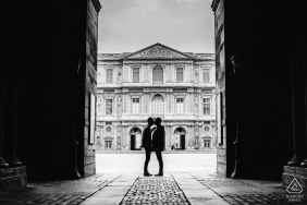 a Paris, France Couple kissing in front of the Louvres