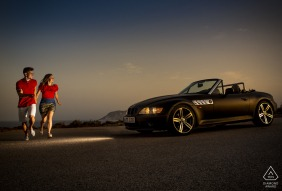 Aguilas engagement photo session with a Sunset and a convertible car