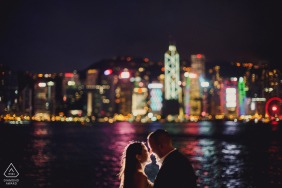 engaged Couple kissing with hong kong in the back ground for their pre-wedding portraits