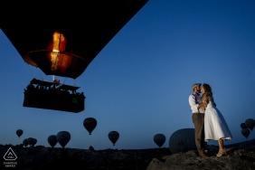 A cappadocia pre wedding session at sunrise during the launch of many hot air balloons