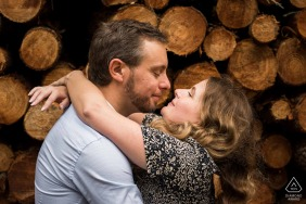 Hosssegor France engagement session in the forest against a stack of cut firewood