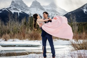 A couple posing for engagement portraits Together in the nature in Canmore, AB, Canada