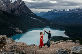 Canada couple holding the hands during engagement photo shoot at Peyto Lake, AB