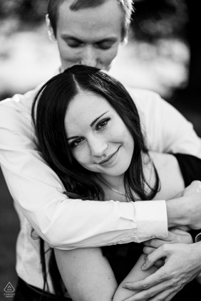 a Rosice Hugging couple are posing for black and white engagement portraits