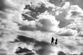 Austin TX engagement portrait amongst the sky and clouds