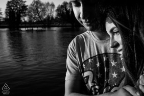 a Windsor, England (United Kingdom) sweet romantic minute for portraits at river thames during engagement shoot session