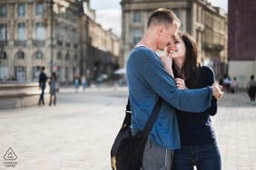 A couple embrace on another for a prewedding engagement portrait in Bordeaux, France