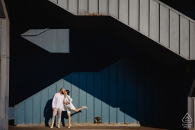 Istanbul engagement photographer captured a couple in a geometric frame under Galata Bride
