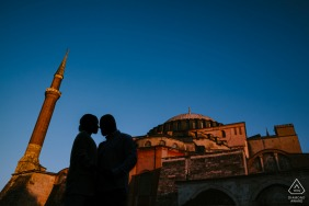 An İstanbul Turkey (Ayasofya) couple posing in front of the Hagia Sophia church for their engagement portraits