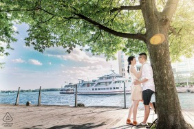 Toronto, Ontario couple engagement portrait under a tree at a port with boats