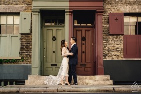 A couple embracing each other in a doorway in a London Engagement Portrait
