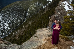 A romantic moment with the engaged couple on the edge of a huge cliff at Juniper Pass, Colorado