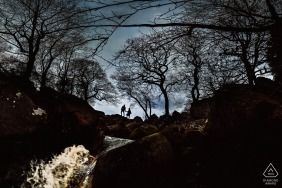 padley gorge, peak distrsict. northern England portrait silhouette of engaged couple over waterfalls