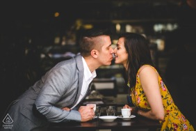 a Couple takes a coffee in a café in Florence during Engagement photo session
