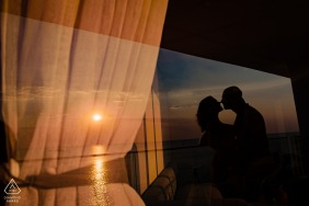 Phu Quoc Island couple posing for portraits at sunset with glass reflection