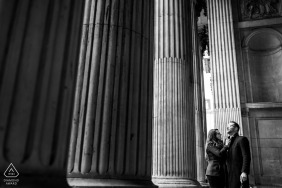 London, UK couple posing for portraits Under the columns of St Paul's Cathedral