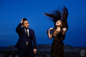 cappadocia, turkey engagement photo session with a light, blue sky, and flying hair