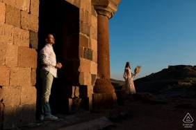 a Cool portait of couple in evening sun of Ani ruins, Turkey
